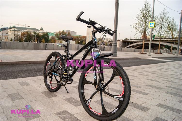 Велосипед на литых дисках двух-подвесной